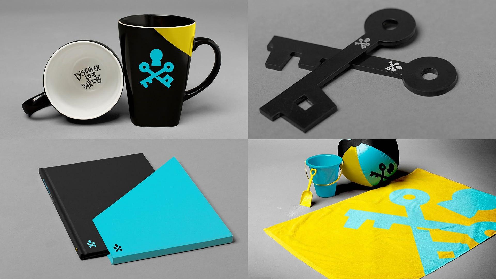 Coffee mugs, branded keys, brand book with holder and beach towel, beach ball and beach bucket.
