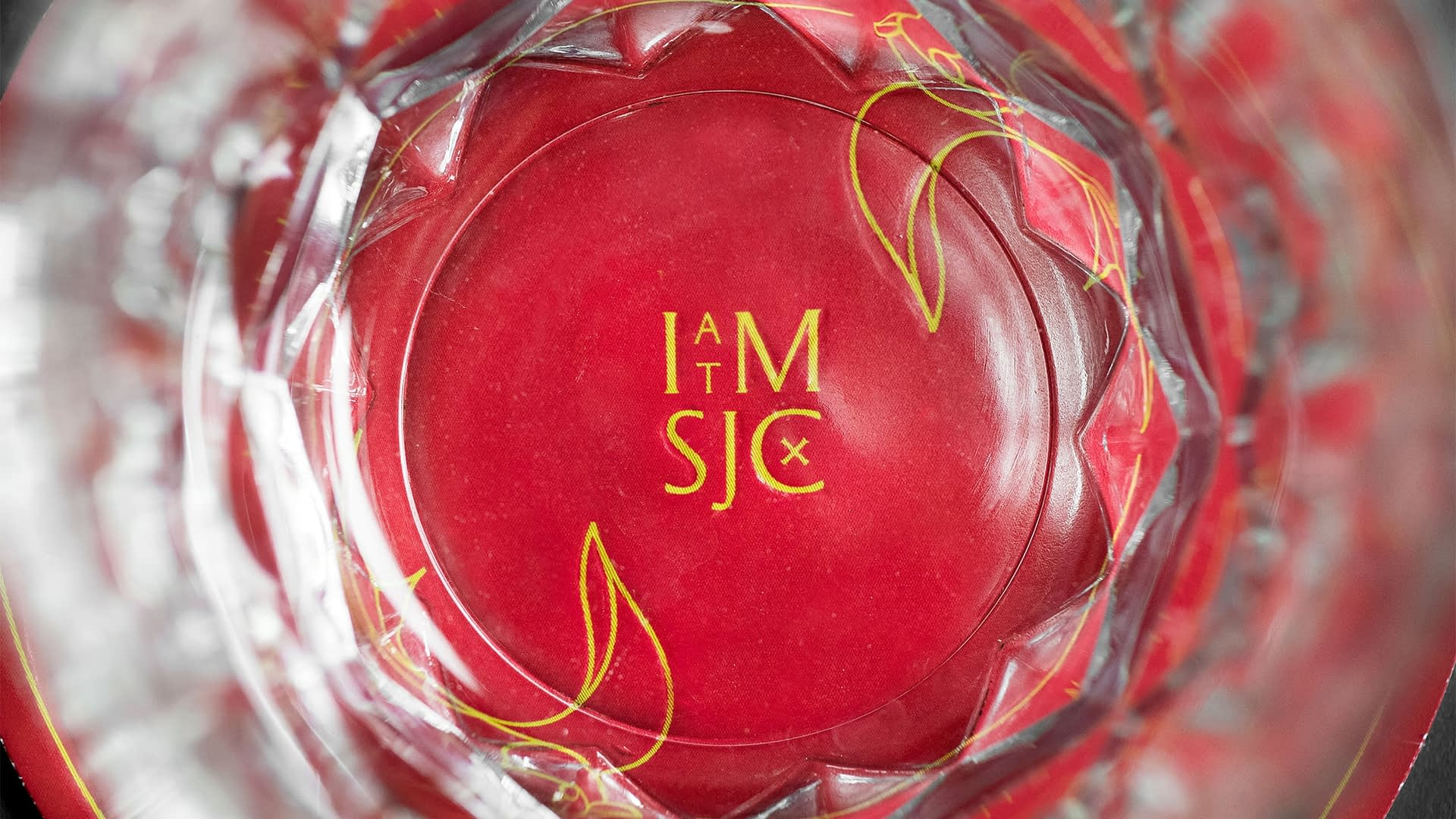 Branded coster view through drinking glass - A sample of the hotel branding work done for Inn At The Mission