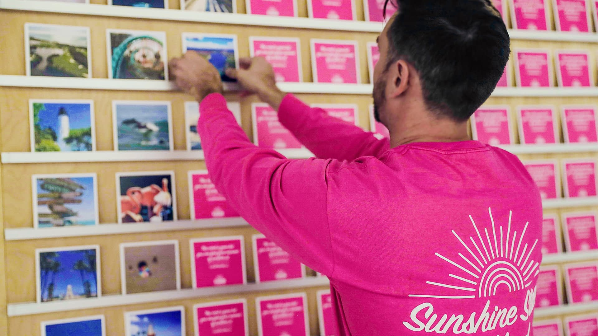 Man holding photo for VISIT FLORIDA Moments of Sunshine creative campaign