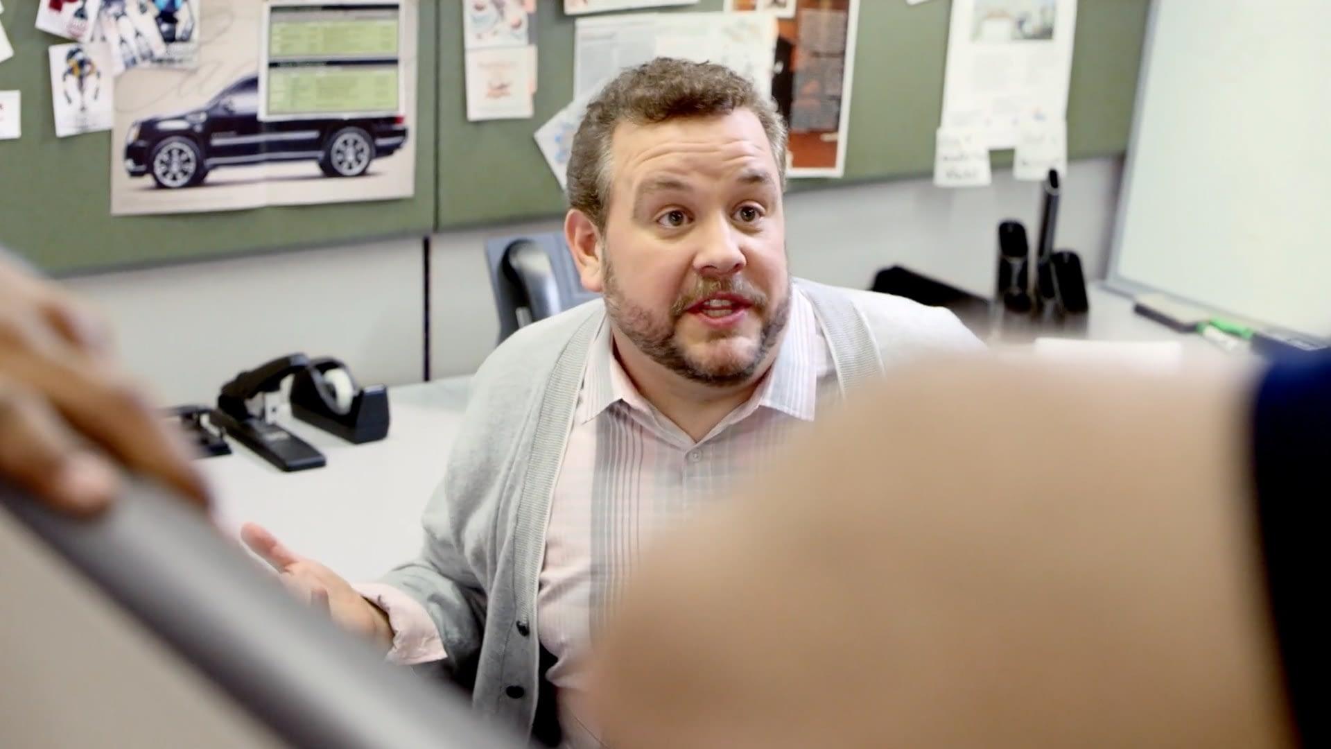 AVI employee looks at engineer