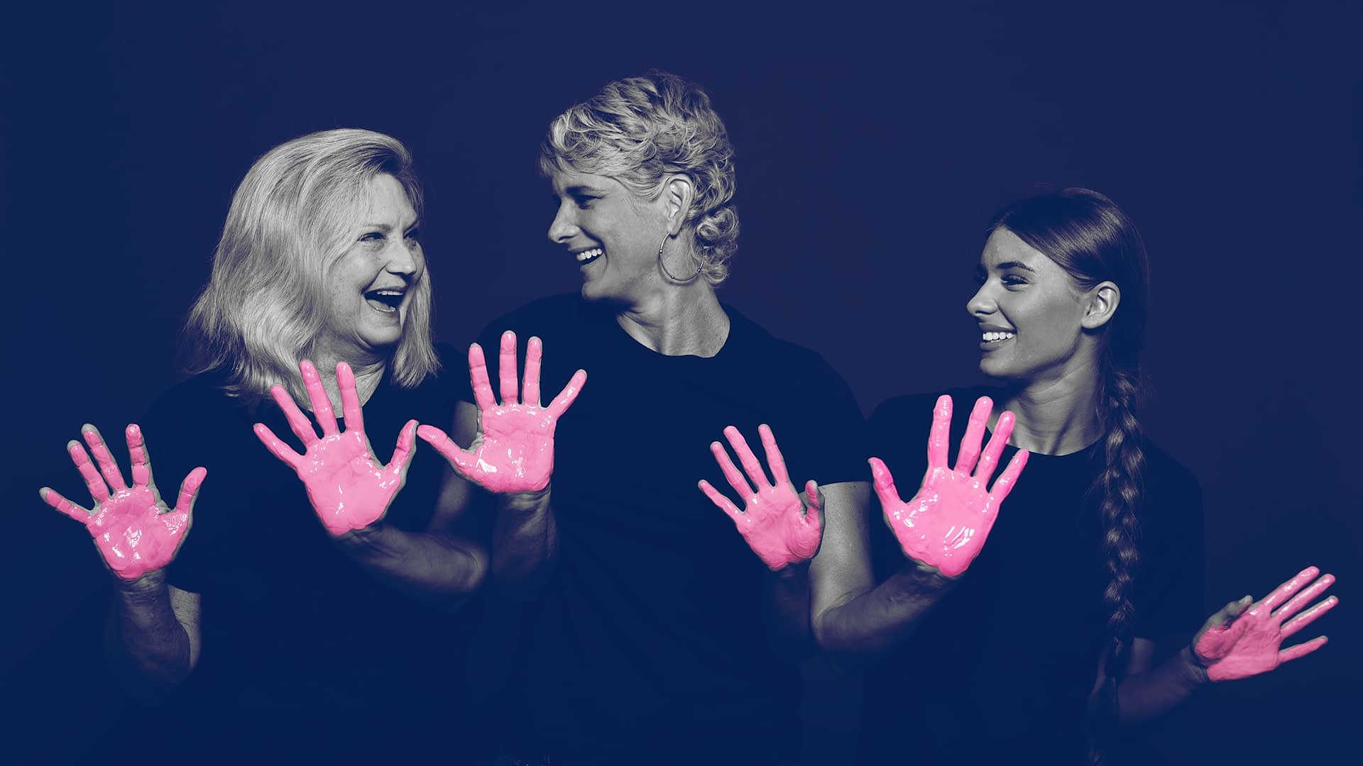 A breast cancer survivor and her family posing for the in our hands campaign with pink paint on their hands. BayCare Hospital Marketing campaign