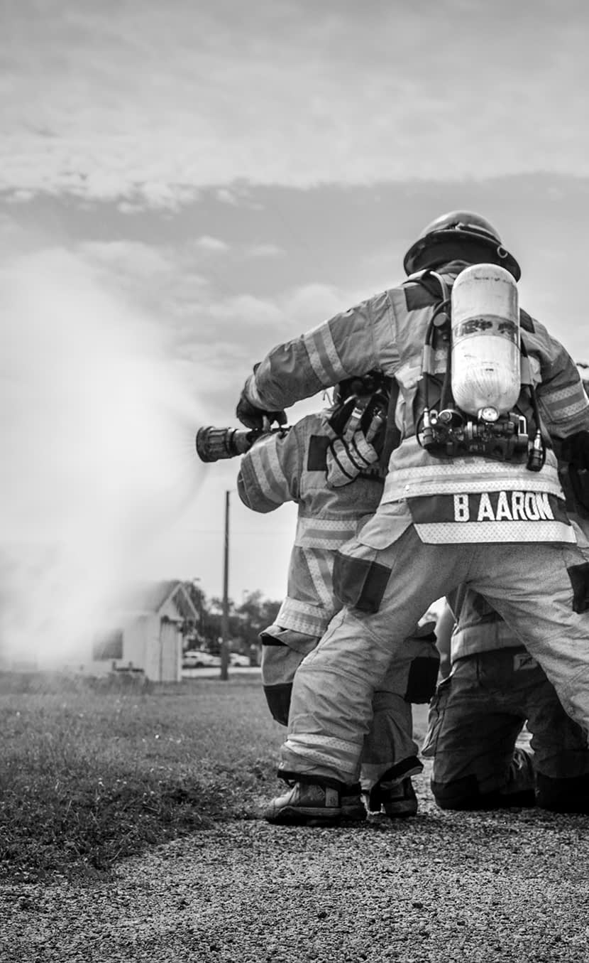 Make-A-Wish Firefighters Using Hose Vertical