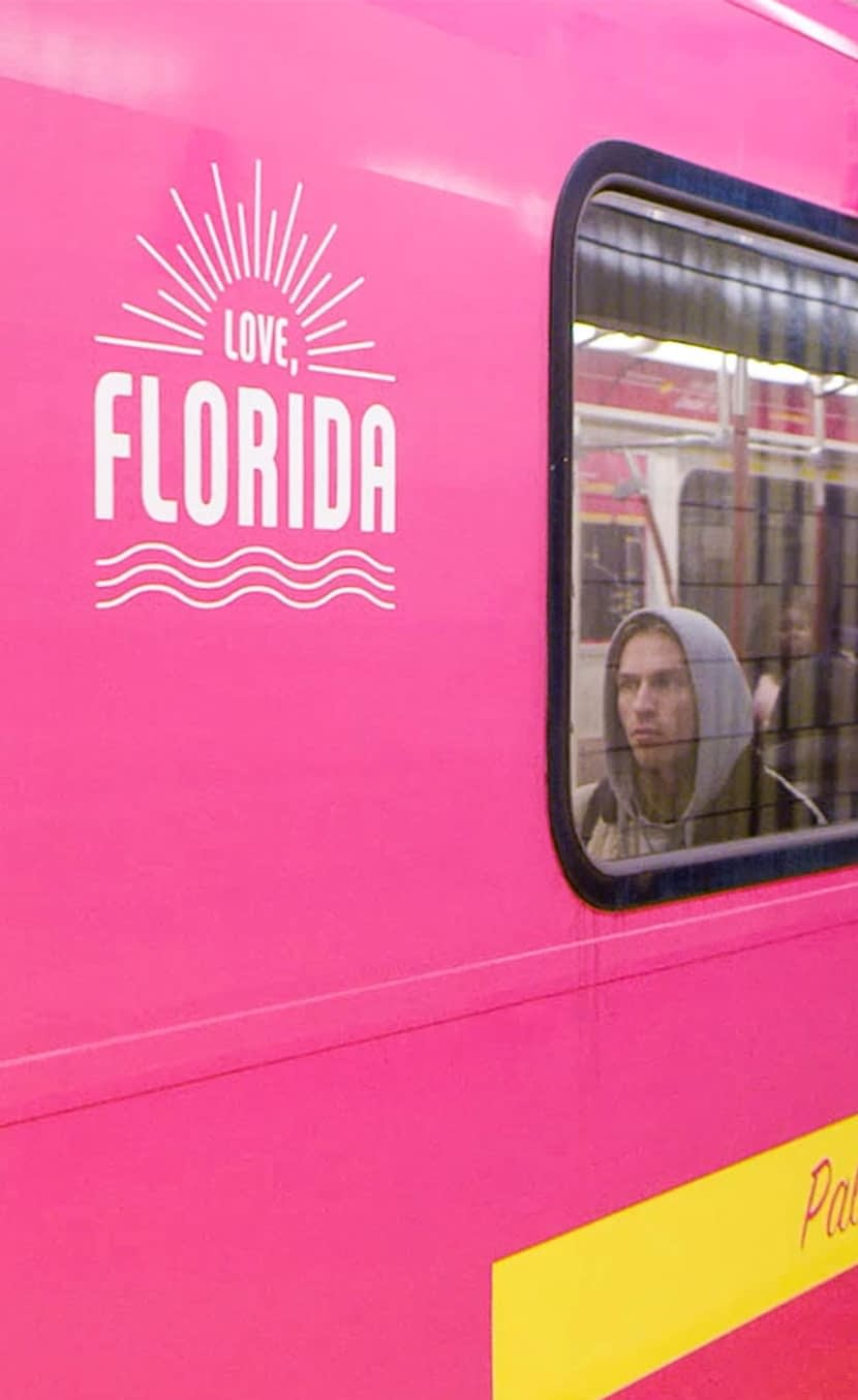 Subway train wrapped in bright pink for VISIT FLORIDA's sunshine line tourism marketing campaign