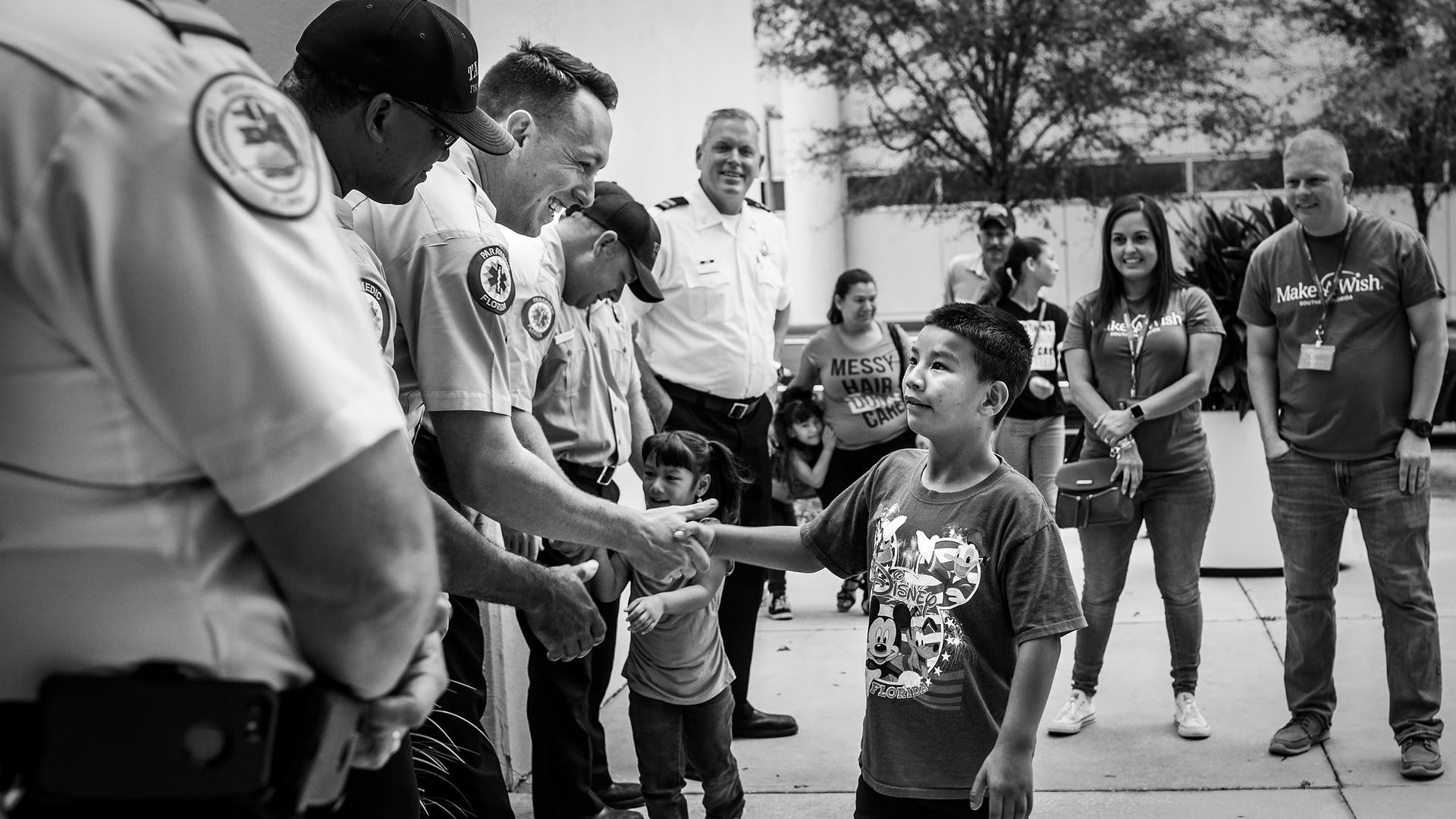 Make-A-Wish Boy Firefighters Shake Hands