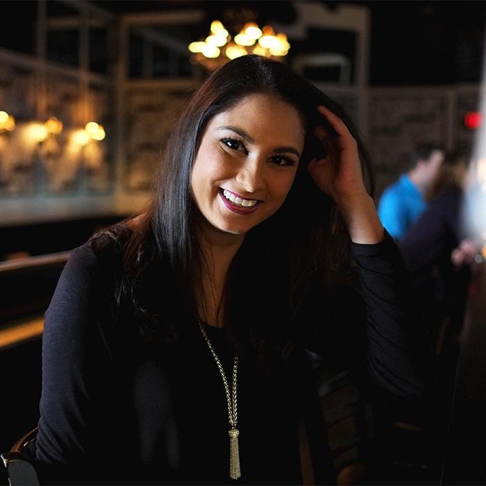 Asian woman smiles at camera