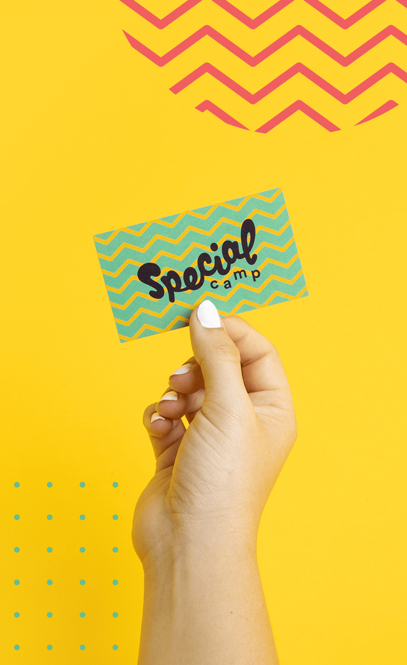 A hand holding up the special camp business card —from our nonprofit rebrand intiative, STOKED.