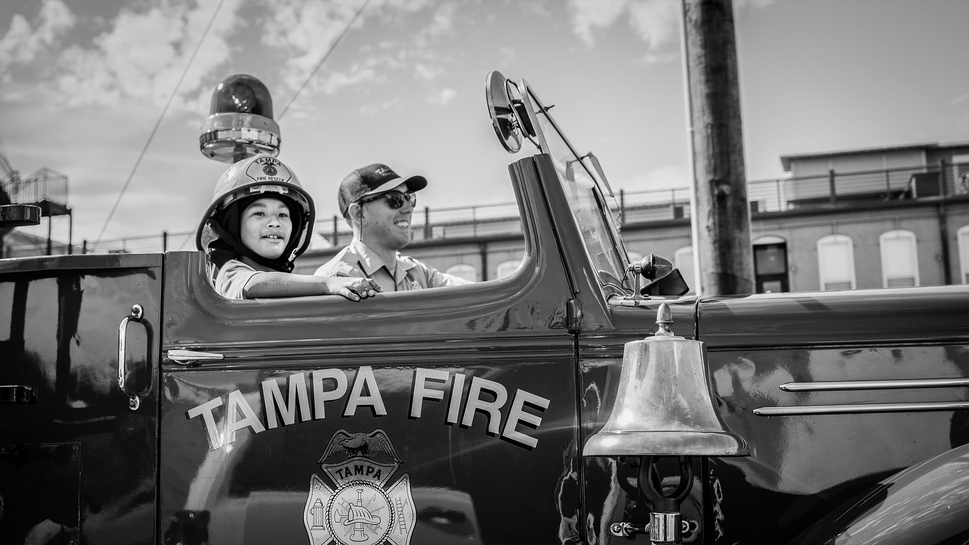 Make-A-Wish Boy Riding In Fire Truck