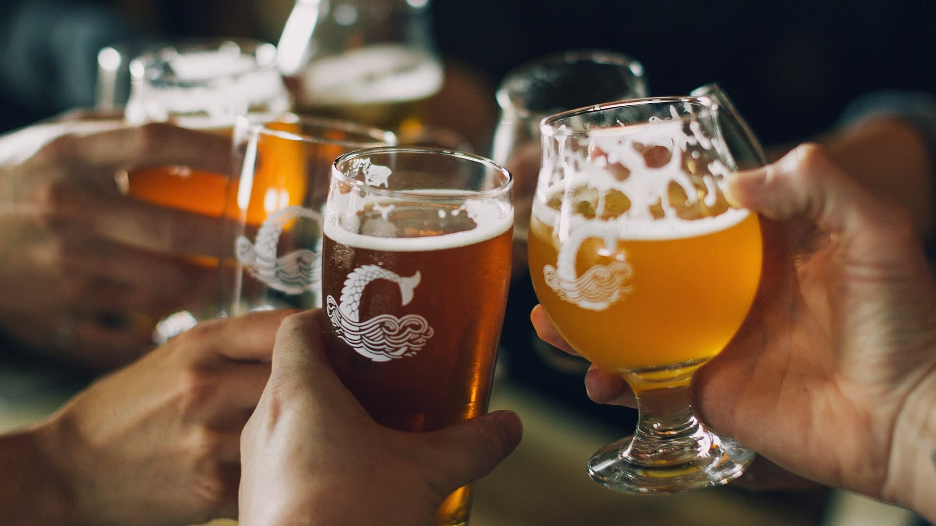 Coppertail beer in branded glasses