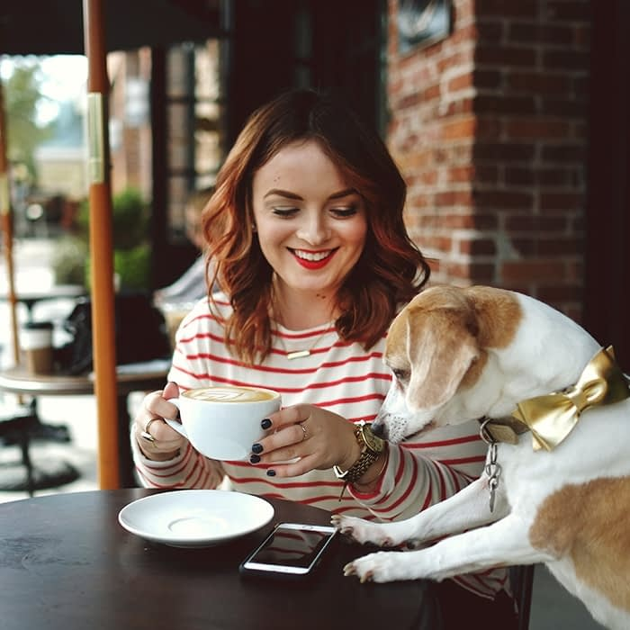 Woman with coffee and dog