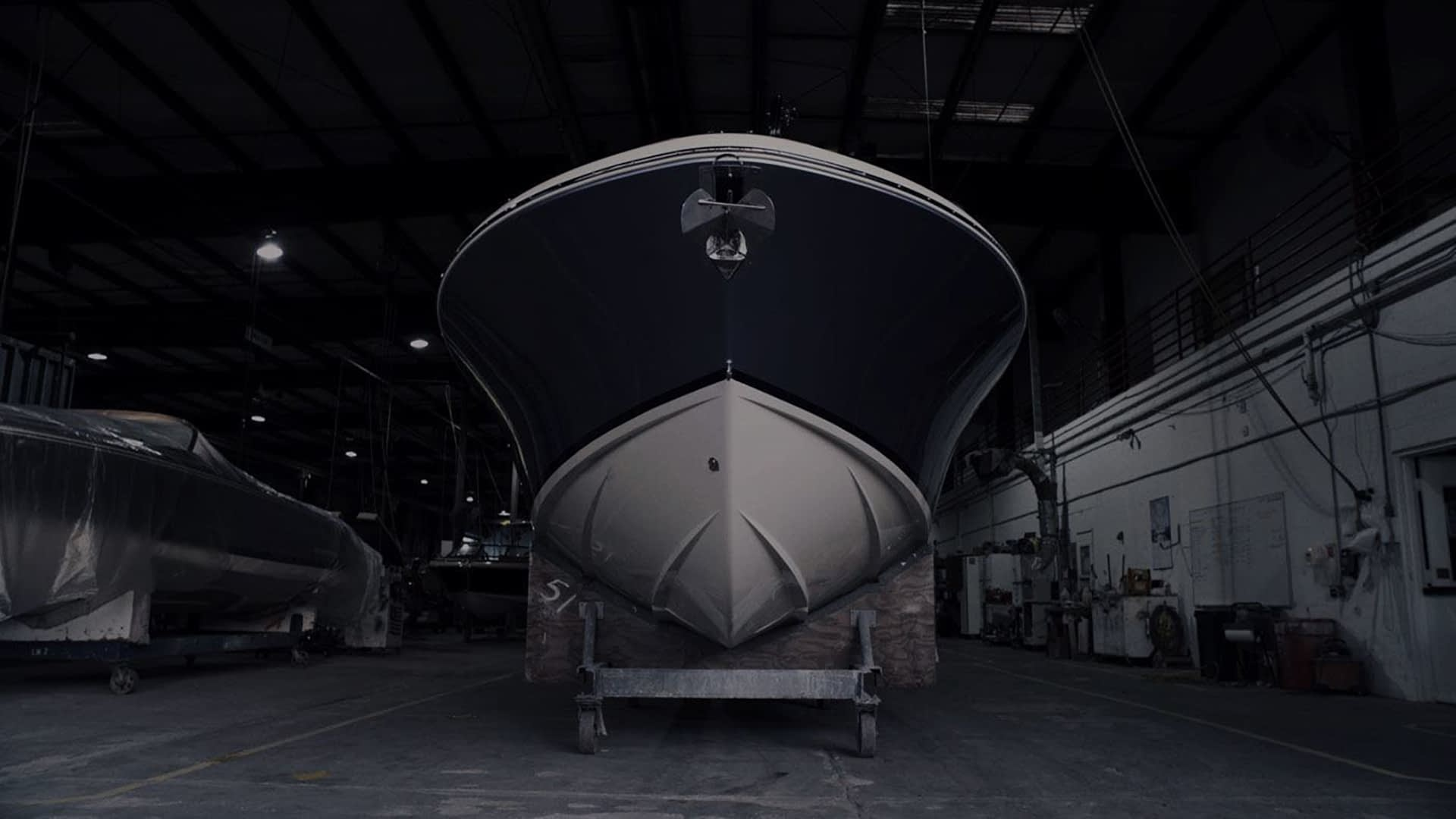 Chris Craft boat in garage