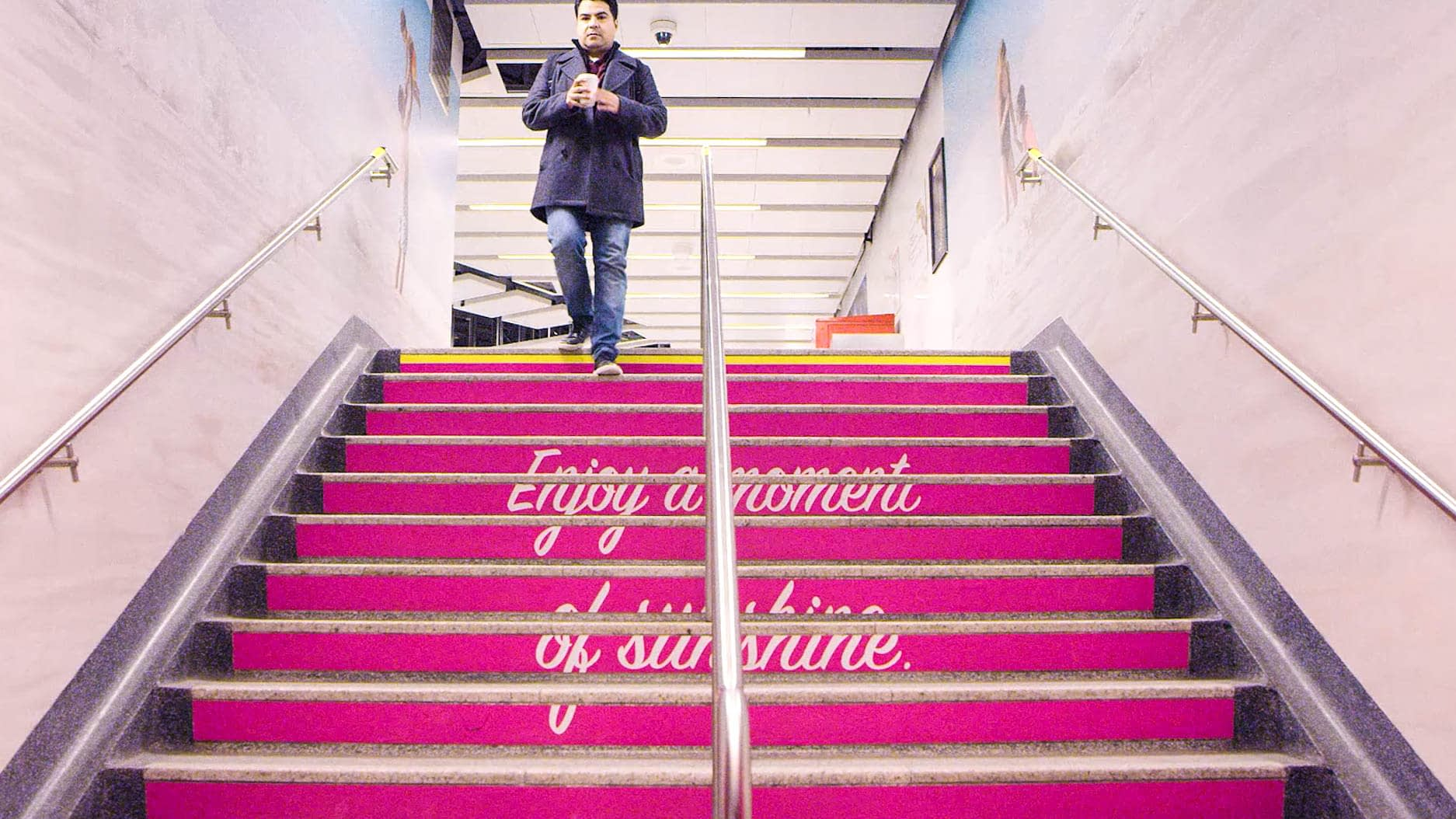 Photo of a staircase turned pink that says