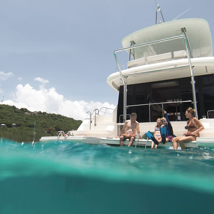 Privileged family on boat in the ocean