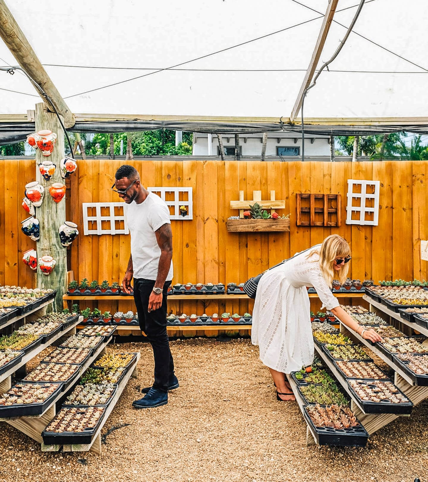 Couple shopping in an outdoor market for our experience seekers integrated campaign