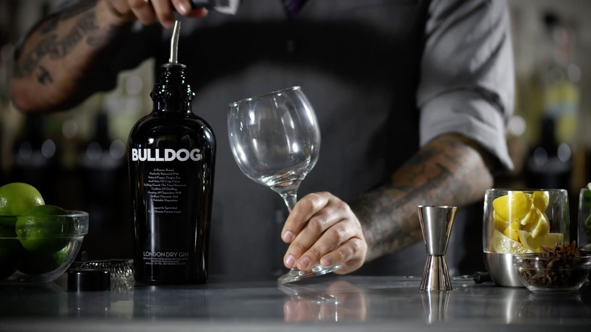 A bartender about to make a drink with bulldog gin.